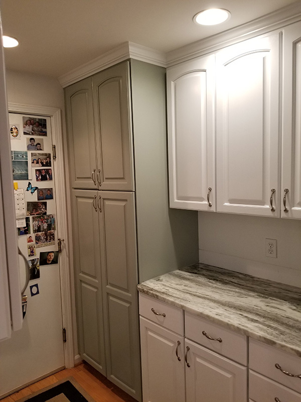 white cabinets with green accented cabinets-600w